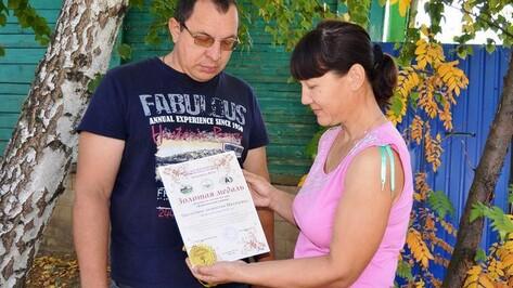 Супругов из Бутурлиновки на агровыставке наградили золотой медалью за розы