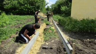 Общественники нижнедевицкого села Першино построят пешеходную дорожку