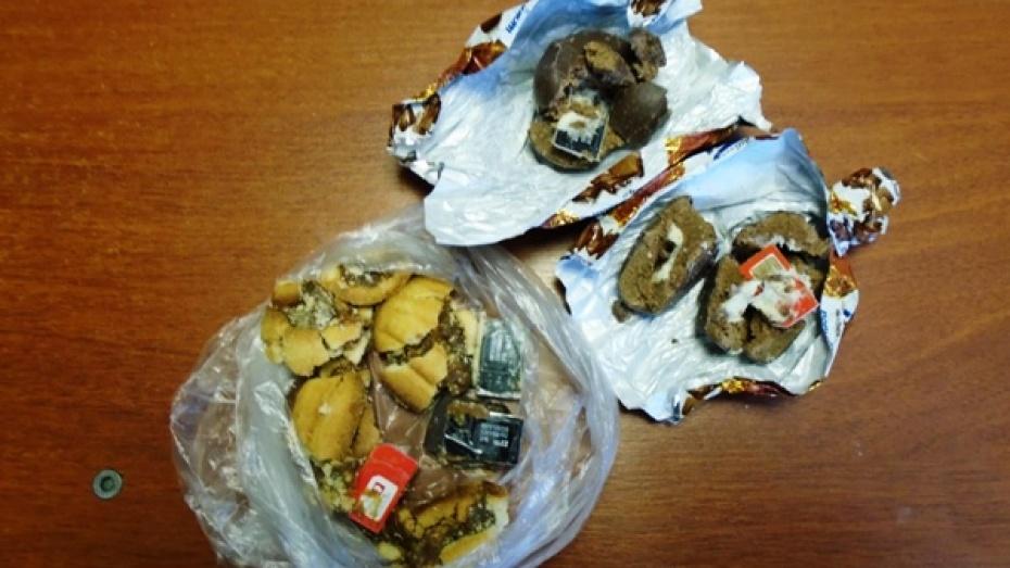 Женщина передала в воронежскую колонию сим-карты в конфетах и печенье