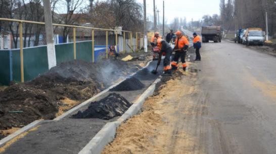 В воробьевском поселке Первомайский построили тротуар на улице Шевченко